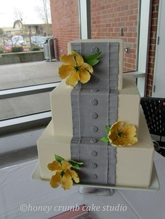 Grey Box-Pleated Wedding Cake with Yellow Sugar Blooms | by HoneyCrumb