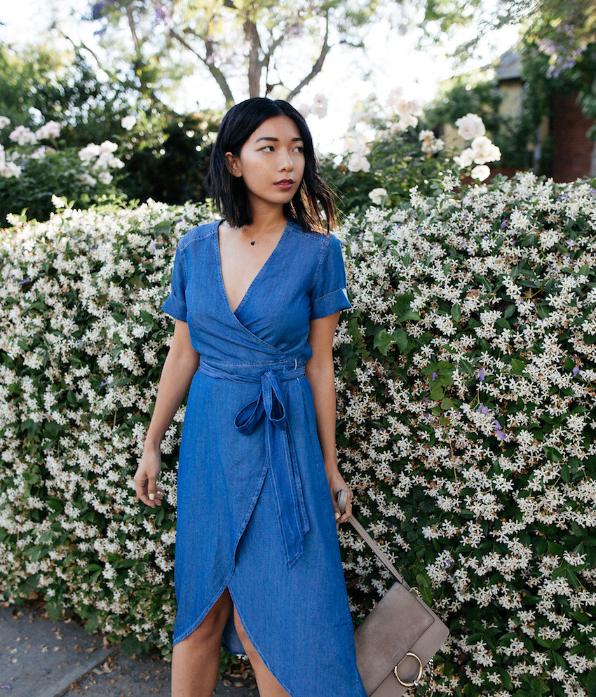 Stephanie Liu of Honey & Silk wearing 7 For All Mankind Denim Wrap Dress, Chloe Faye Bag, and Gucci Heels.