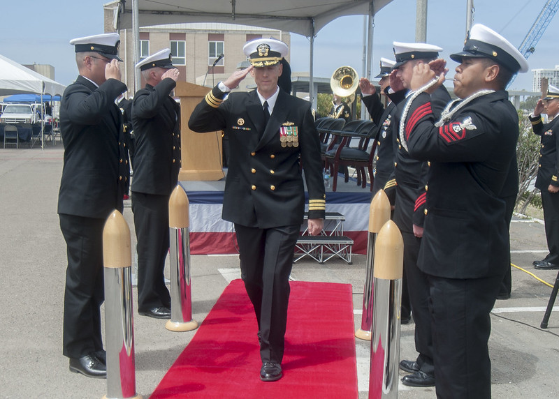 Cmdr. Neil Krueger, Commander Assault Craft Unit (ACU) 1 commanding officer, is rendered honors after assuming command.