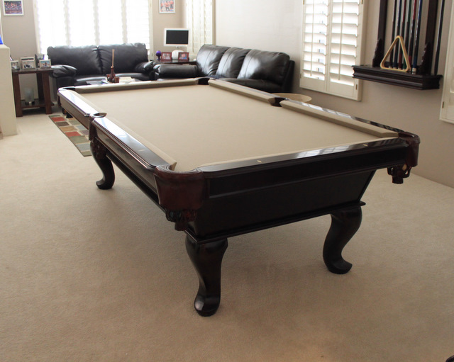 Pool table with off-colored leg
