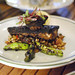 blackened local sea bass sweet corn succotash, blistered shishito peppers
