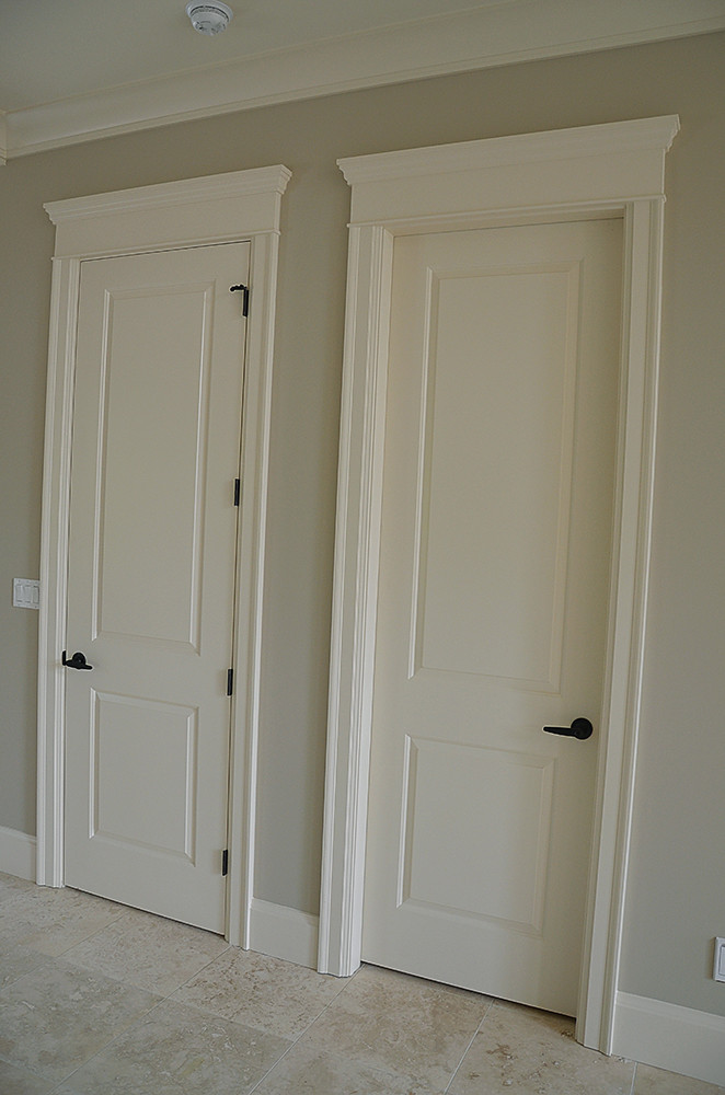 Twin interior doors with individual header construction for Interior door construction
