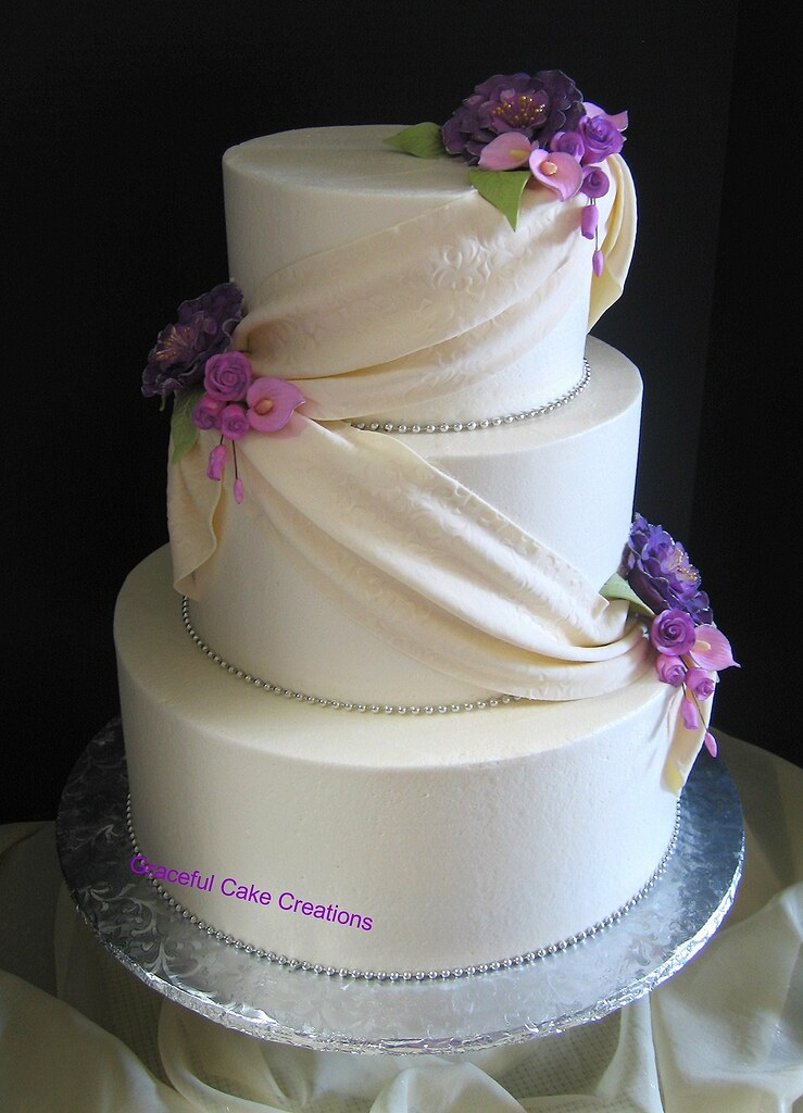 ivory wedding cake with purple roses ivory wedding cake with purple peonies lavender r 16552