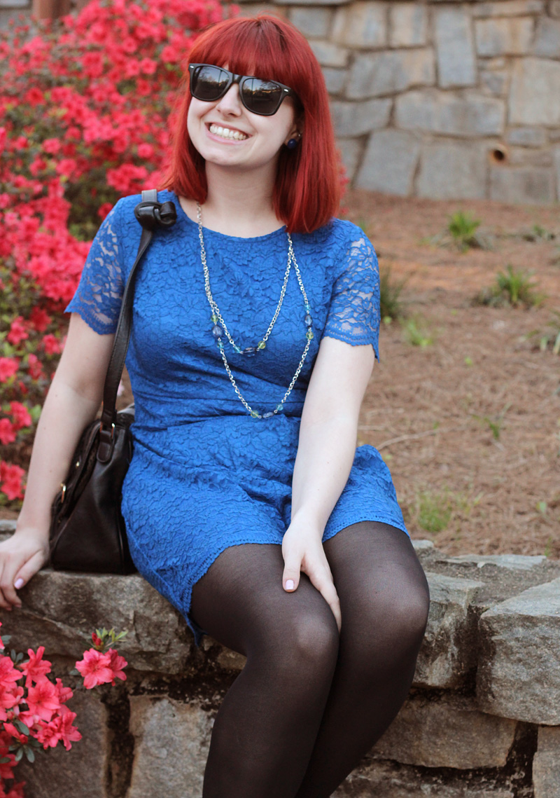 Cobalt Blue Romper, Beaded Necklace, Wayfarer Sunglasses, and Bright Red Hair