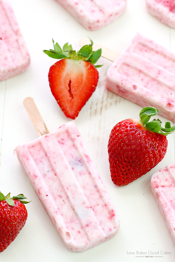 Strawberry Yogurt Popsicles with fresh strawberries.