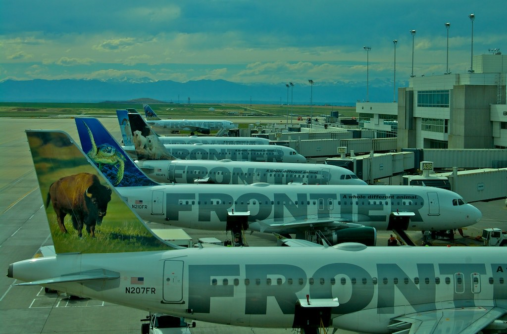 Animal logos | Frontier airlines with tail-fin logos, in ...