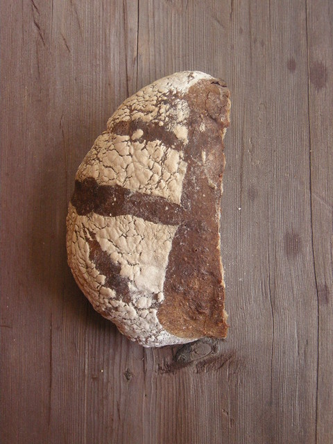 Loaf of bread baked in ad hoc oven (half eaten)