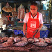 Grilling fish at a market in Vientiane, Laos.