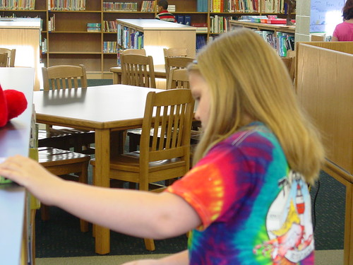 Camille looking for a book_1 | by sc_association_school_librarians