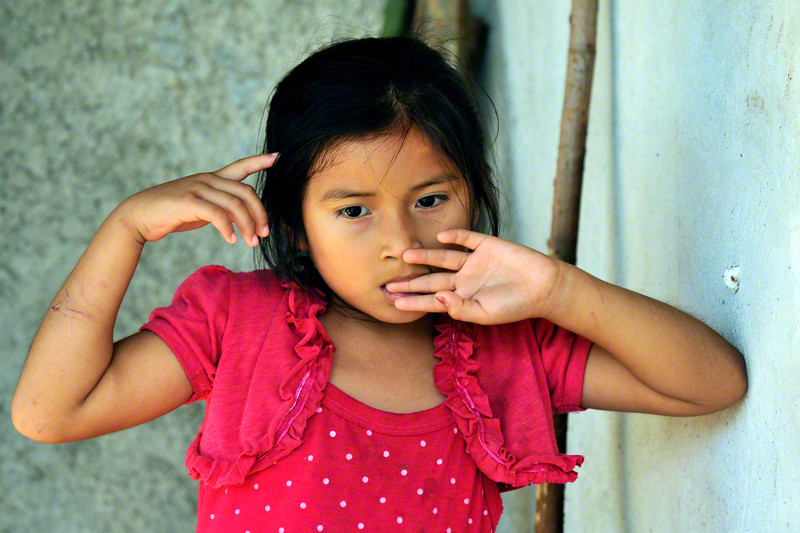 Sweet Mayan little girl lost in her thoughts. Mayan villag ...