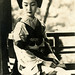 Maiko Fumi sitting on a Balcony 1940