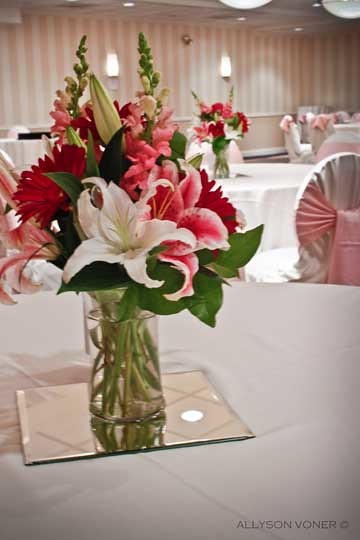 Lilies and snapdragon vase centerpiece of