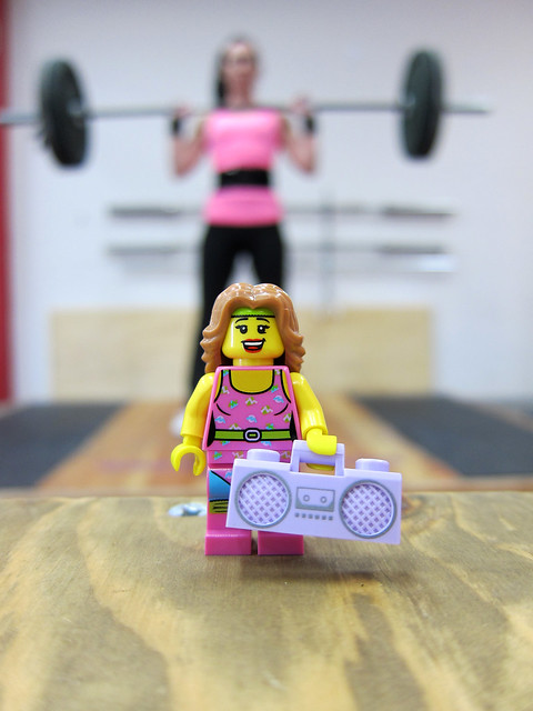 an image of woman lifting weights