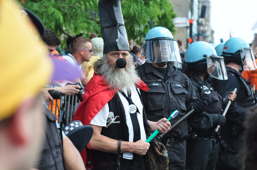 Vermin Supreme with riot police #2 | Toothbrush at the ...