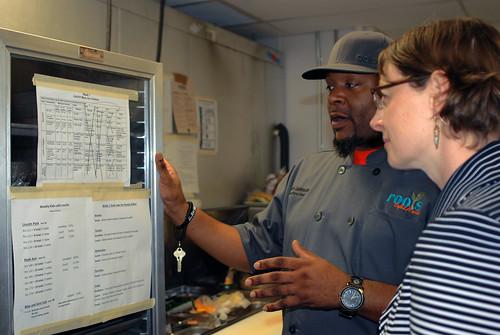 Executive Chef Jason Johnson explaining his preschool menu to Administrator Starmer