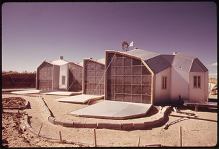 Exterior picture of the south facing walls of a modular solar-heated home near Corrales, New Mexico..., 04/1974 | by The U.S. National Archives