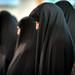 Iranian women in chador pray