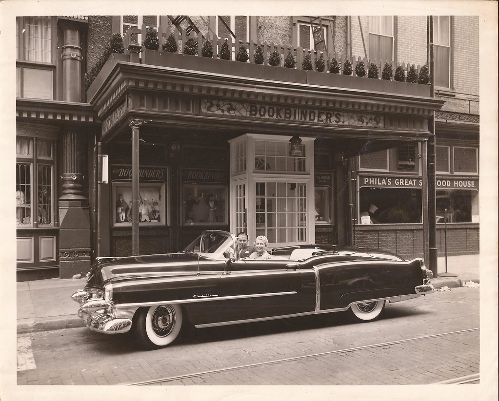 Jean And John M Taxin In Cadillac In Front Of Old Origina