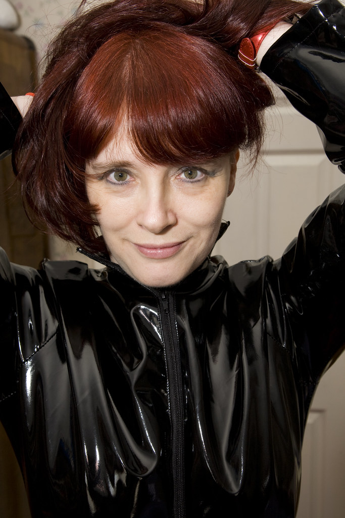 Linda shows off her new catsuit, cincher and silver pvc r ...