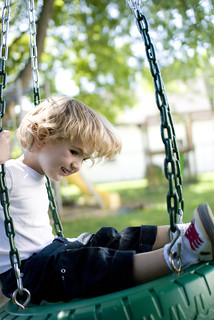 boy on tire swing | by cara slifka