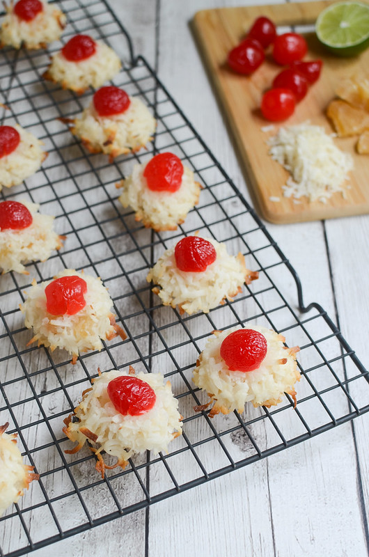 Ambrosia Macaroons - delicious coconut cookies filled with orange zest, lime juice, and dried pineapple. And topped with a cherry!
