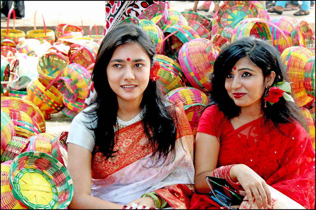Girls in sarees on Saraswati Puja. Source ~ flickr.com