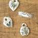 assorted charms and leaf ring