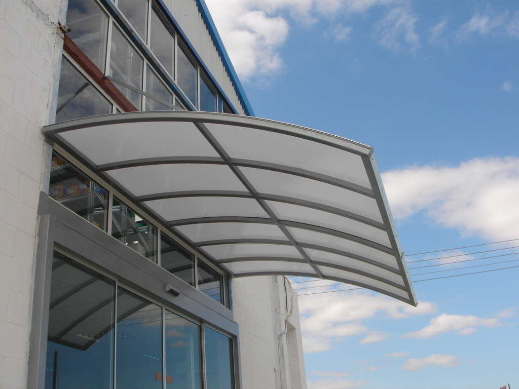 Suspended Curved Metal Canopy With Lexan Suspended
