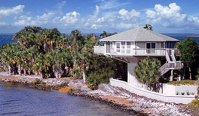 Topsider homes concrete homes built on piers plans stilt for Concrete pilings for house