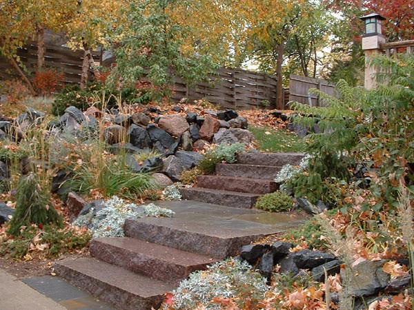 Carnelian granite steps with trap rock and purple quartz r for Landscaping rocks quartz