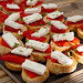 Crostini with roasted peppers and feta cheese