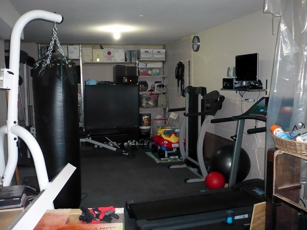 Fitness area in the garage equipment heavy bag