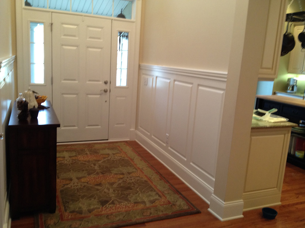 Two Story Foyer Wainscoting : Classic raised panel wainscoting in a foyer by