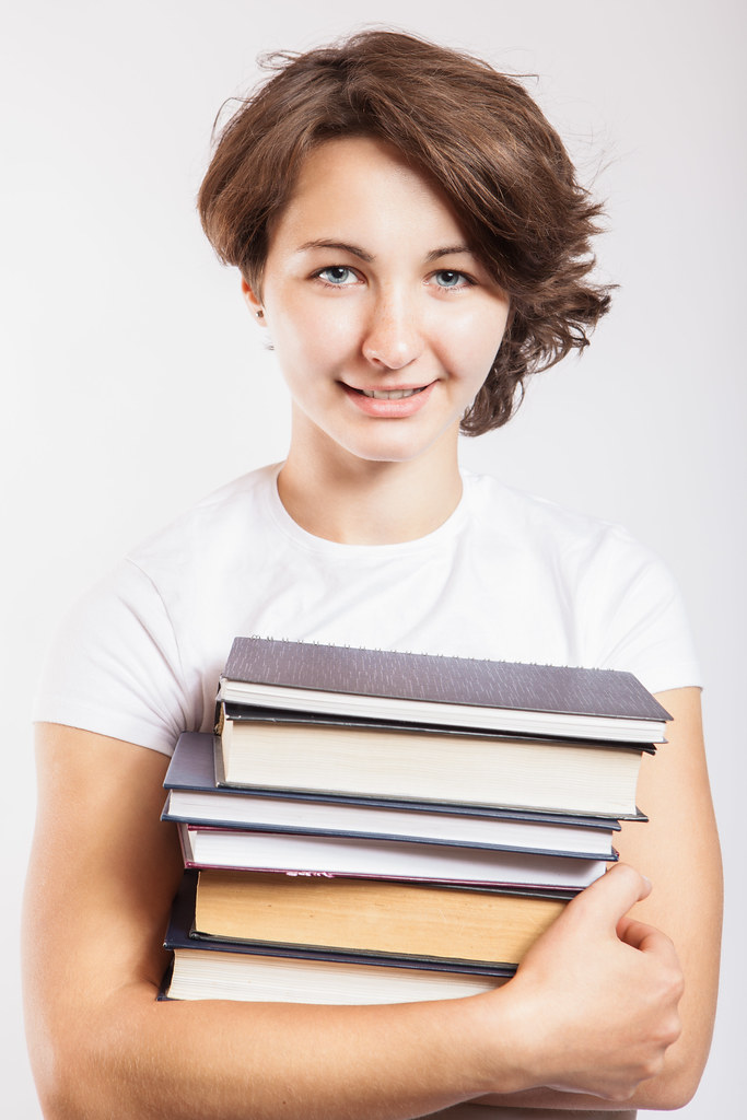 female student holding library books a young female