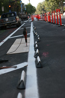 rubber curbs installed 4th street Cycletrack | by Richard Masoner / Cyclelicious