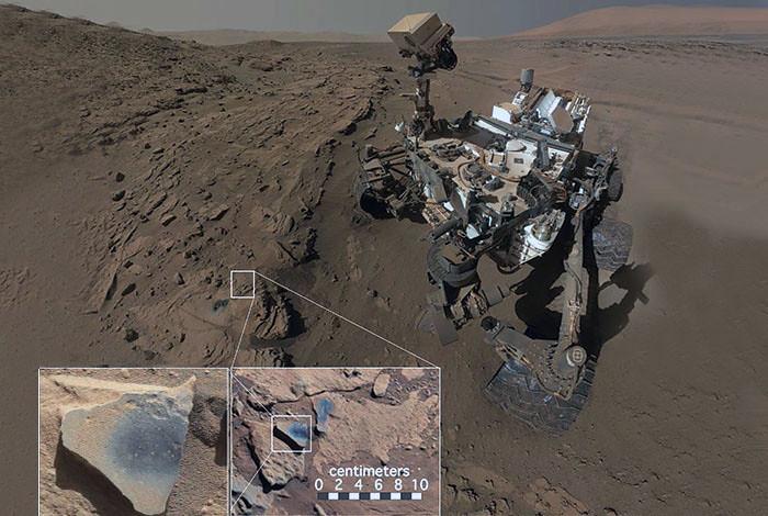 El robot Curiosity examina la formación Kimberley en el cráter Gale, en Marte. Frente al robot se aprecian dos agujeros practicados con la broca de recogida de muestras del vehículo, así como varias estructuras de tono oscuro que han sido limpiadas de polvo (ver recuadros). Estas estructuras planas, que rellenaron las fisuras, son resistentes a la erosión y ricos en óxidos de manganeso. (Fotos: MSSS/JPL/NASA)