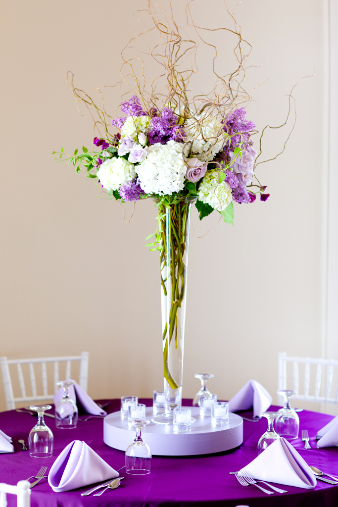 Purple and green tall centerpiece photo by freeland