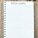 "Spiral notebook with ""2012 Goals"" written at the top"