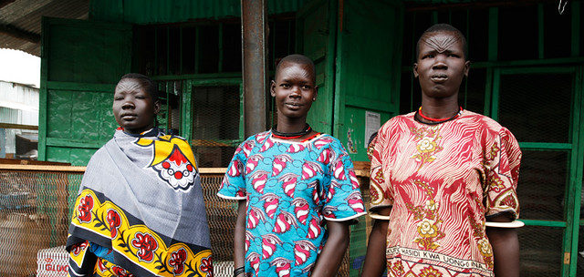 Three African Women in Traditional Kitenge Garb