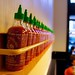 Sriracha Sauce lined up at ShopHouse Restaurant 3