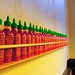 Sriracha Sauce lined up at ShopHouse Restaurant