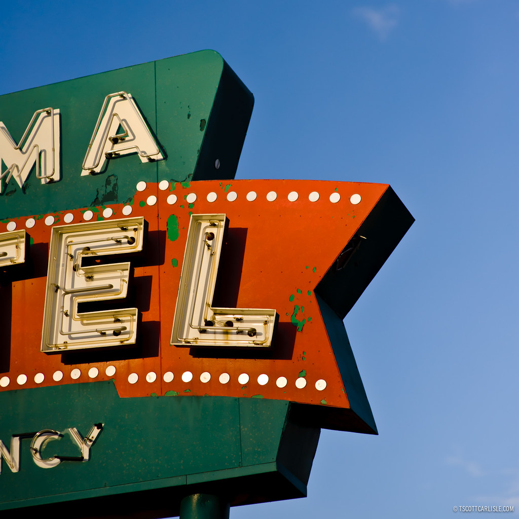 An Old Motel Sign With Neon. Letters Are