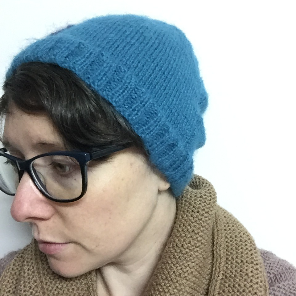 a simple bright blue beanie, used in my blog header