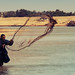 Local Man Using a Net to Catch Fish in a River on the Outskirts of Essaouira - Morocco