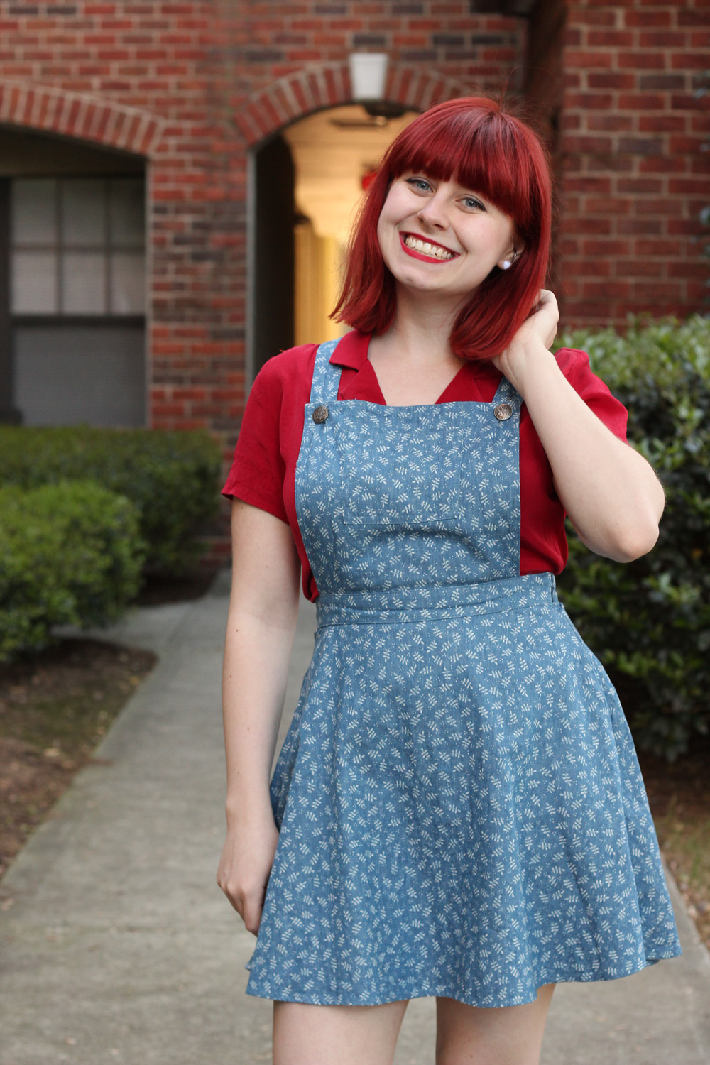 Red Button Down Top with a Leaf Patterned Denim Pinafore Dress