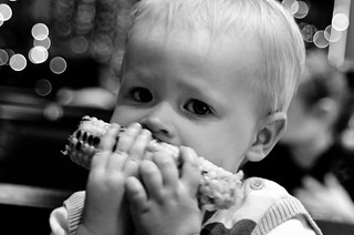 Nom! My son tucking in a cob of corn | by gifster1983