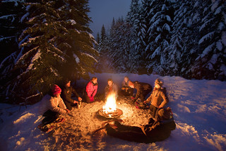a photo of people around a winter campfire