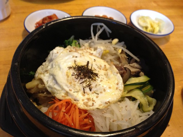 Dolsot bibim bap served in a hot stoneware bowl which for Asia cuisine ithaca