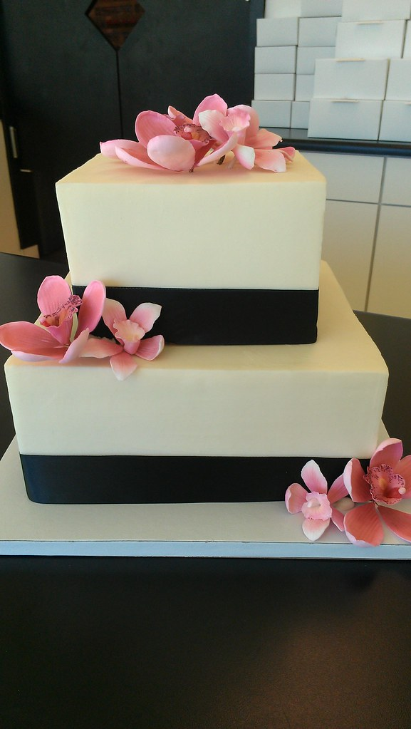 square 2 tier wedding cakes two tier square black ribbon with edible flowers wedding 20340
