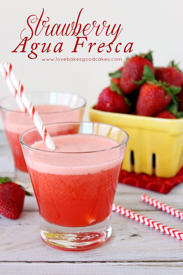 Strawbery Agua Fresca in two glasses with fresh strawberries.